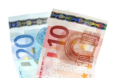 Two notes of 10 and 20 euros on white background photo