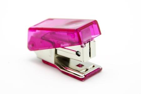 stapler: Pink stapler on white background