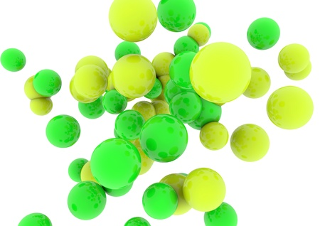 Yellow spheres and green glossy  on white background photo