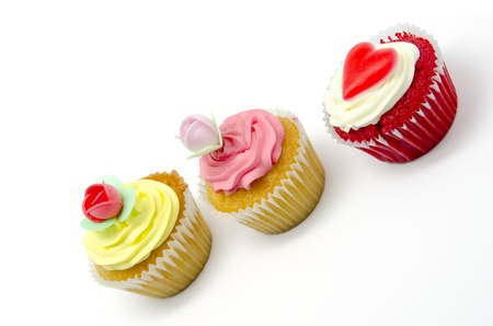 A colorful cupcake on white background photo