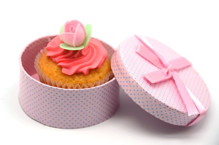 Cupcake in a gift box on white background photo
