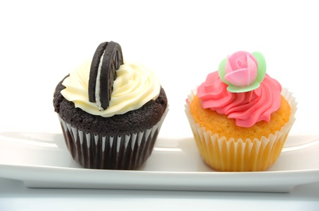 Two cupcakes on a dish on white background photo