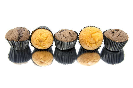 Fresh muffins  isolated on white background with reflection photo