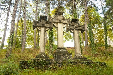 Three stone Celtic crosses in the woods photo