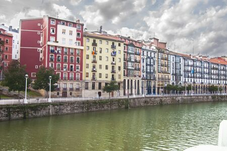 Buildings in the city of Bilbao one day with stormy sky photo