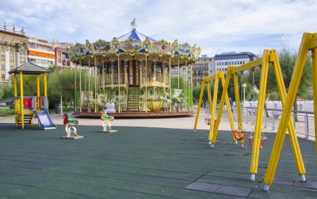 Carousel next to a playground in the city Stock Photo - 16391340