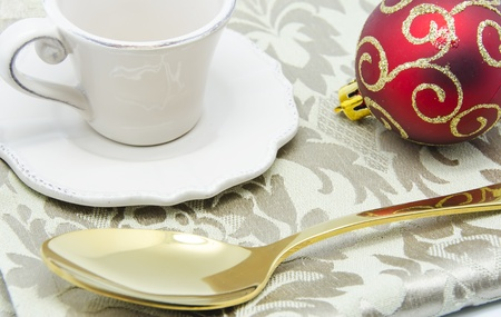 Christmas decorative background with a cup and spoon photo