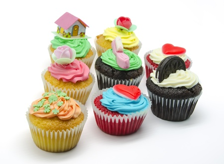 A colorful cupcakes on white background photo