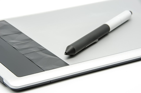 Graphics tablet with pen on white background photo