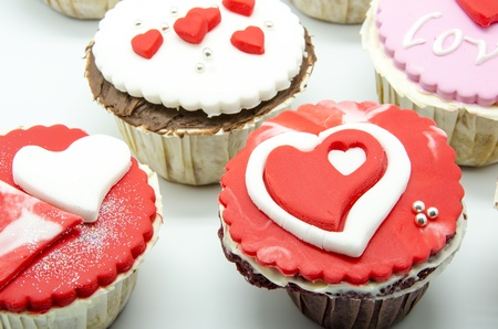 Gourmet cupcakes with hearts and decorations Stock Photo - 17594507