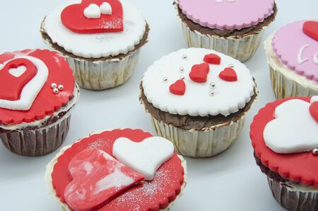 Gourmet cupcakes with hearts and decorations photo