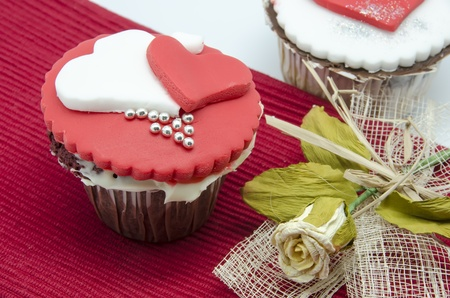 Gourmet cupcakes with hearts and decorations Stock Photo - 17594518