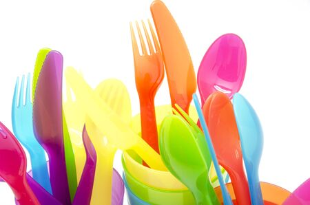 recycle plastic: Colored   cutlery on white background