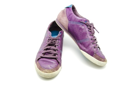 Purple shoes worn over white background photo