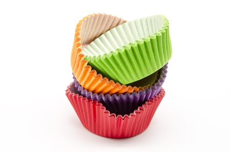 Colorful cupcake cases on white background photo