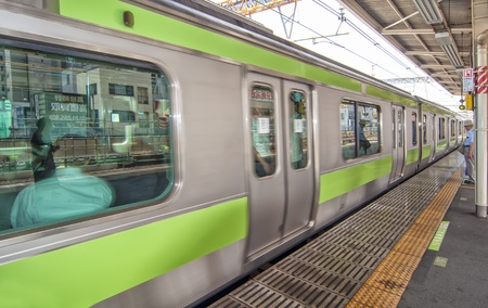 TOKYO,JAPAN-JULY 5:Yamanote line at Ueno train station on July 5,2011 in Tokyo,Japan. It is an urban line trian high in some parts of Tokyo�s most important and busiest city.