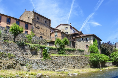picos: Typical houses in Potes medieval with blue  Stock Photo