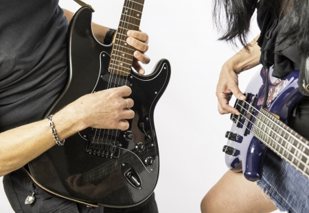 Man and woman playing guitar on white background photo