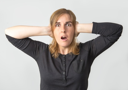 Surprised woman on a white background Stock Photo - 21819577