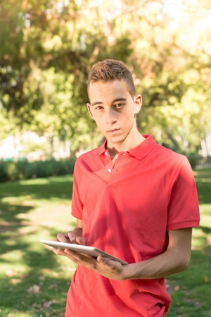 Young man with table in the park photo