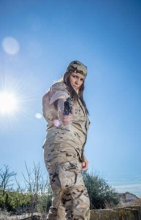 Spanish military girl pointing her gun photo