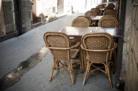Wicker chairs and tables in La Guardia, Spain photo