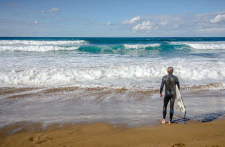 Surfer watching the waves in Zarautz, Spain photo