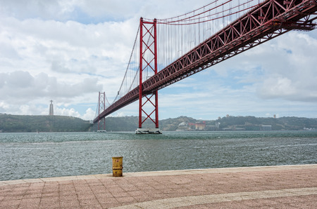 Bridge april 25, Lisbon, Portugal, on a cloudy day photo