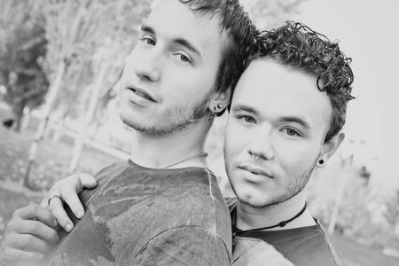 Loving gay couple in outsite photo