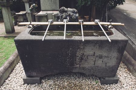 purifying: Typical source for purification in a Japanese temple