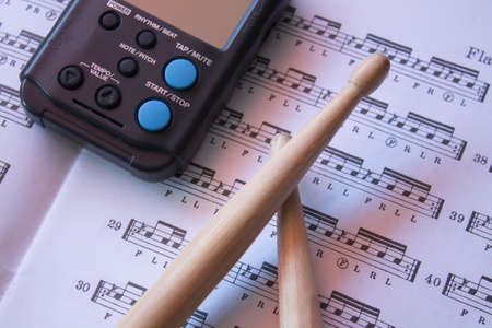 drum sticks: drum sticks and metronome on music theory book