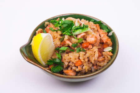 preparing food: seafood fried rice in bowl isolated on white background