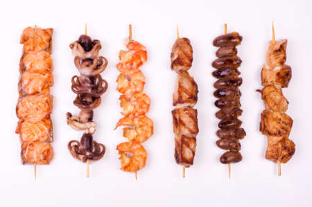 set of different meat skewers  isolated onwhite background photo