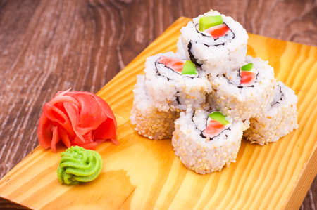 inside out: inside out sushi roll with salmon and avocado on wooden background Stock Photo