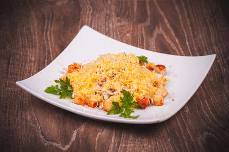 crouton: salad with bacon, crouton and cheese on white plate Stock Photo