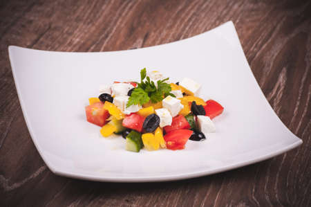 bell peper: vegetarian greek salad served on white plate Stock Photo