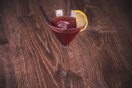 alcohol cosmopolitan cocktail in glass with straw