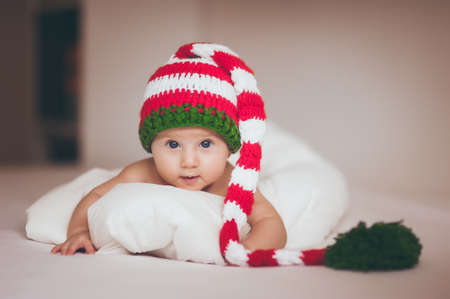 christmas baby girl newborn in new year hat Reklamní fotografie