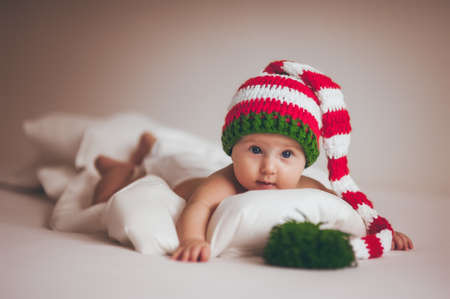 newborns: christmas baby girl newborn in new year hat Stock Photo