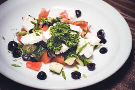 bell peper: vegetarian greek salad served on white plate Stock Photo