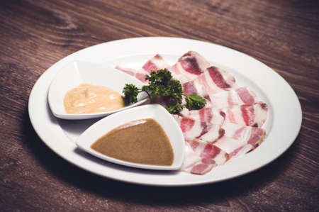porc: slised salo porc fat bacon with horseredish
