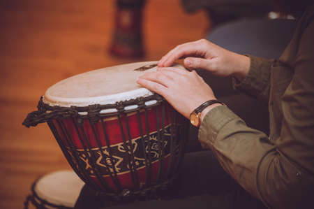 bongo drum: person playing on Jambe Drum no face Stock Photo