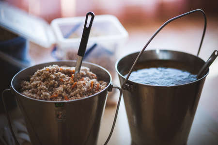homeless people: food for homeless people served in bucket Stock Photo