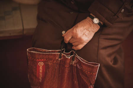 beg: pure old men holding bag  no face Stock Photo