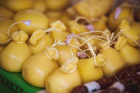 caciocavallo: many forms of CACIOCAVALLO CHEESE sold at local market Stock Photo