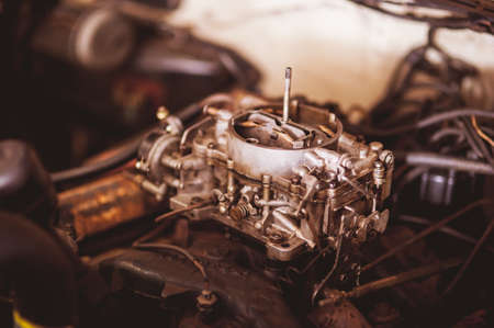 worthless: Used carburetor from the fuel supply system of gasoline engine vintage Stock Photo