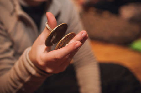cymbals: Bronze cymbals castanets on women hand  no face