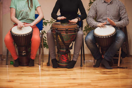 Group of Jambe drummers playing no face 스톡 콘텐츠