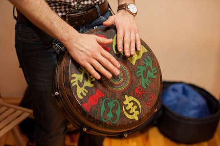 men playing on Jambe Drum no face