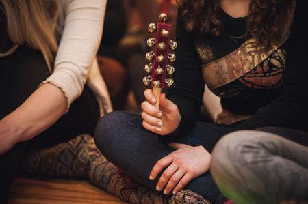 no face: women playing Hand Sleigh Bells no face Stock Photo
